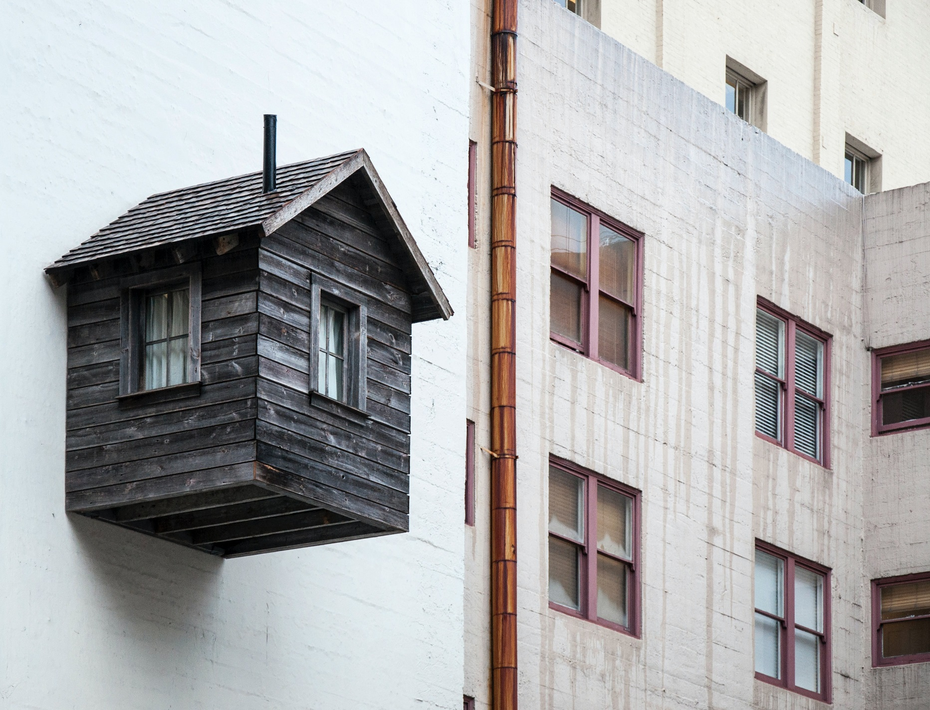 Old building coming out of a modern facade in San Francisco